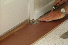 sawing off door casing to fit laminate flooring