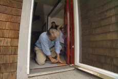 un-mounting the door to remove lead paint
