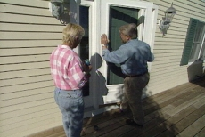 positioning the frame to install the storm door