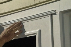 caulking the drip cap to install the storm door