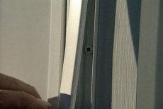 snapping trim over screws as we install a storm door