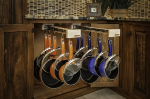A hanging rack for pot and pan lids that glides in and out