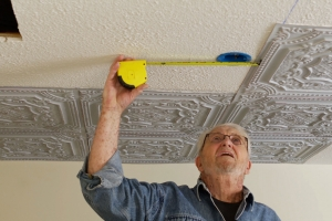 PVC Tiles Are A Stunning Way to Hide Outdated Popcorn Ceilings