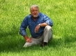 Ron Hazelton sitting in grass