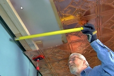 Installing copper ceiling edge tiles
