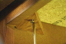 loosening fasteners beneath the kitchen countertop