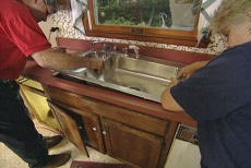 dropping the sink into the kitchen countertop cutout