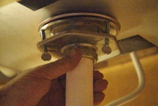 attaching the drain pipes beneath the kitchen counter and sink