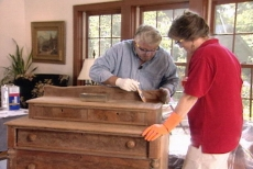 examining the stains on the antique furniture