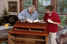 wiping excess stain off the antique furniture
