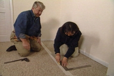 scoring the closet carpet with a utility knife