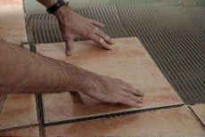 seating the tiles in the thin-set mortar