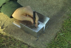 inserting an expansion anchor into concrete