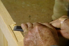 Using the chisel to clean the high spots from the hinge mortise