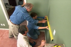 ensuring the decorative wall frame panels are plumb and level