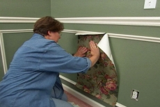 pasting wallpaper within the decorative wall frames