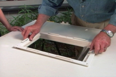 positioning the pet door's interior frame
