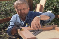 drilling a clearance hole in the planter bench end frames