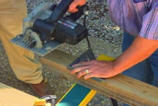 cutting wooden components with circular saw and combination level