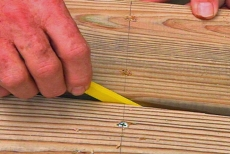 spacing deck planks with a carpenter's pencil