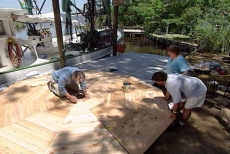 Placing the floor panels onto the joists