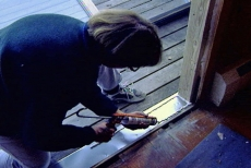 caulking the rectangular perimeter of the threshold flashing