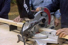 cutting two-by-four framing with a power saw