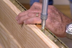 drilling pilot holes through the piano hinges