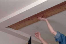 Installing the tongue and groove planks to create a solid ceiling panel