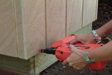 covering the wall frames with exterior sheathing