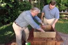 setting the pressure-treated plywood liner in the planter