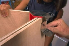 Using a joiner clamp to hold the sides in place