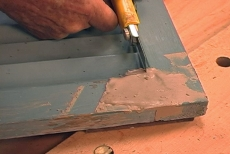 shaping wood filler edges with a utility knife