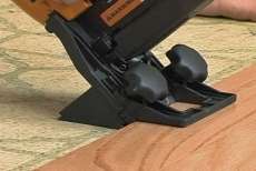 securing hardwood flooring planks with a special stapler