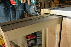 Attaching glides in pantry cabinet