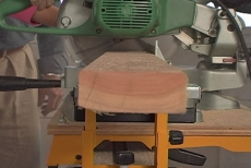 sawing two-by-fours for knee wall divider framing