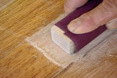 sanding with a block and fine sandpaper