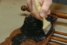 glazing the details of the antique chair