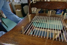 reweaving the antique chair's cane seat