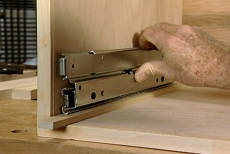 installing the drawer glides for the pull-out shelves
