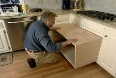 testing the pull-out shelves beneath the cook top