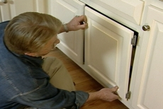 remounting the cabinet doors over the pull-out shelves