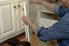 securing a replacement stile to the cabinet door