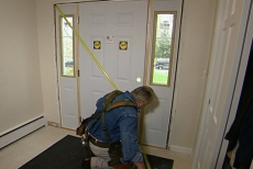 Measuring the door unit to see if it is square