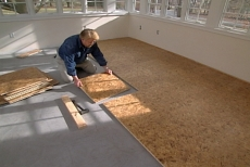 Laying the sub-floor into place