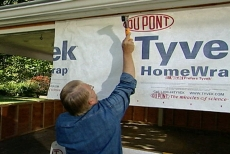 Tacking Tyvek housewrap on the exterior to weatherproof the new room