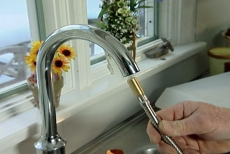 inserting the spray nozzle into the kitchen faucet