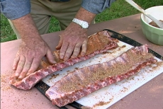 rubbing spices into ribs