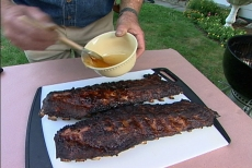 brushing honey on ribs