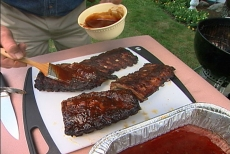 brushing sauce on ribs